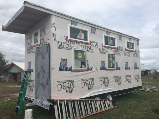 IT'S GETTING DRESSED: WINDOWS IN, HOUSE WRAP ON