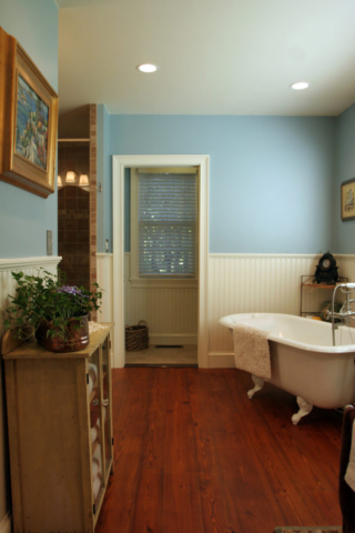 AFTER: BY RECONFIGURING THE SPACE THE BATHROOM IS MADE FOR TWO