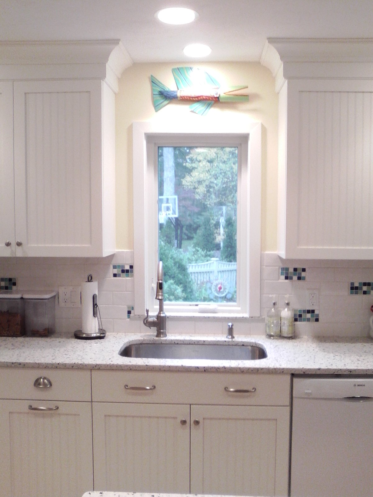 AFTER: A SMALLER WINDOW CREATES PRIVACY AND ADDS MORE WALL CABINETS