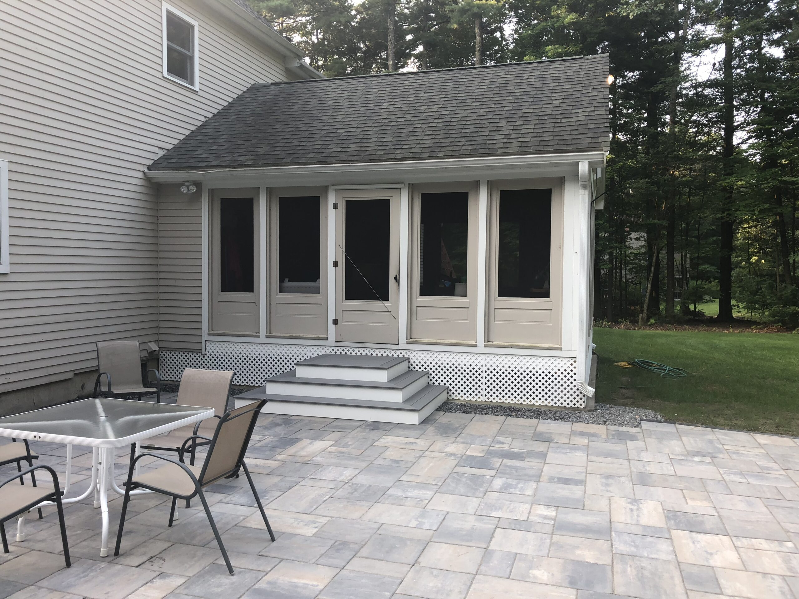 TER: SQUARE STEPS FROM PATIO TO 3 SEASON LIVING ROOM
